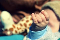 Child's hand playing on toy Stock Images