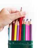 Child's hand pulls one pencil Stock Photo