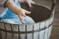 A child`s hand reaching out to us 5521. The child sits in the tub Royalty Free Stock Images