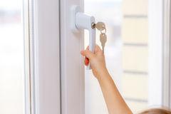 Child's hand on secure window handle Royalty Free Stock Photography