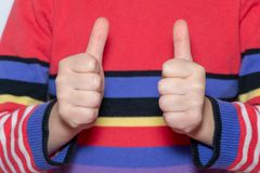 Child& x27;s hand showing thumb up, like, positive sign royalty free stock images