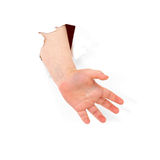 Child's hand stick out from hole Stock Images