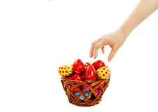 Child's hand takes the eggs from the basket Royalty Free Stock Photography