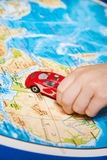 Child's hand with toy car on map of Africa Stock Photos