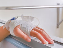 Child's hand who fever patients have IV tube. Royalty Free Stock Photography