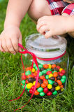 Child's hands with a candy jar Royalty Free Stock Photos