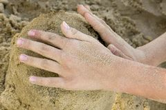 Hands make a sand house stock photos