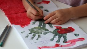Hands of a child draw handles stock video footage