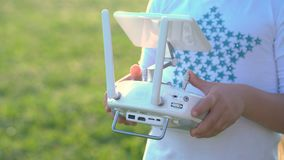 Child`s hands on the drone remote control stock video footage