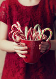 Child's hands holding Christmas candy canes Stock Photo