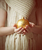 Child's hands holding Christmas ornament Royalty Free Stock Image