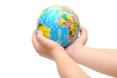 Child's hands holding a globe Royalty Free Stock Photo