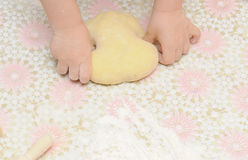 Child's hands kneading dough Stock Image