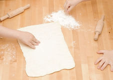 Child's hands kneading dough Royalty Free Stock Images