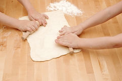 Child's hands kneading dough Stock Images