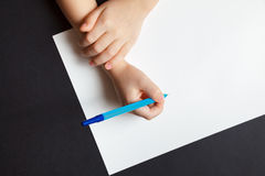 Child`s hands over empty white the sheet of paper Stock Photography