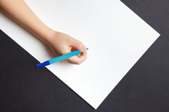 Child`s hands over empty white the sheet of paper Royalty Free Stock Photo
