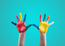 Child's hands painted with multicolored finger paints Royalty Free Stock Images