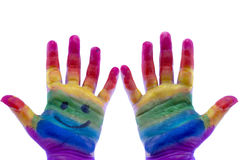 Child's hands painted watercolor on white background. Painted rainbow royalty free stock image