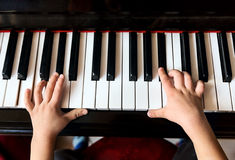 Child's hands playing the piano Stock Image