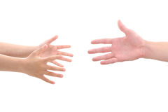 Child's hands reaching for adult's hand. Close-up studio shot of child's hands reaching for adult's hand Royalty Free Stock Photos