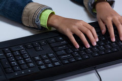 Child's hands typing on keyboard Royalty Free Stock Images