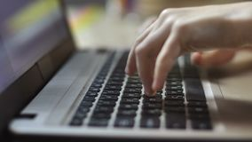 Child`s hands typing on laptop keyboard. Closeup of little girl`s hands typing on laptop keyboard at home. Side view. Primary school girl doing her homework and stock footage
