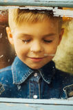 Child`s happy face . Portrait of a Cute Kid. little boy with sh. Ort blond hair and brown yeas. Beautiful little boy seven years posing with a hat and denim stock photography