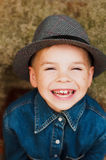 Child`s happy face . Portrait of a Cute Kid. little boy with sh. Ort blond hair and brown yeas. Beautiful little boy seven years posing with a hat and denim stock images