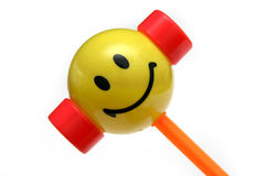 Child's happy hammer. Kid's hammer toy with universal happy face on it stock images