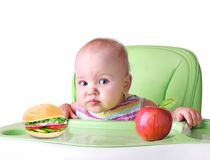 Child`s healthy nutrition concept.Baby eating food.Isolated. royalty free stock photo