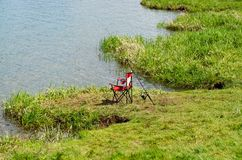 Children`s outdoor chair and fishing gear royalty free stock photography