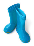 Child's little blue rubber gumboots Royalty Free Stock Images