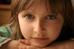 Child's look. Cute little girl with very expressive look Stock Image