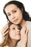 Child's love and tenderness. Hugging of mother and daughter. Child girl with her mother isolated on white stock image