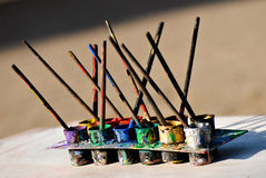 Child's paint pallete and paintbrushes Royalty Free Stock Photos