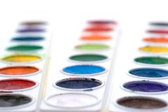 Child's paint trays. Shallow focus closeup of child's paint trays stock photography