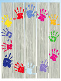 Child's Painted Hand Prints on Fence Royalty Free Stock Photography