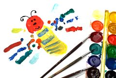 Child's Painting of butterfly. Brushes and paints royalty free stock photography