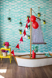 Child's photography studio interior. Ship with flags Stock Photography