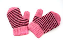 Child's pink mittens with black stripe Stock Photo