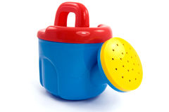 Child's plastic colorful watering-can Stock Image