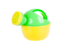 Child's plastic watering can. Beach toy, isolated on white Royalty Free Stock Photo
