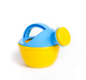 Child's plastic watering can. On a white background. It's blue and yellow Royalty Free Stock Images