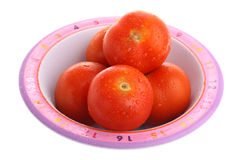 Child's plate full of tomatoes with dew isolated Stock Photo