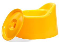 Child's Pot. Yellow small pot with lid on white isolated royalty free stock images