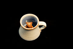 Child's pottery mug with bear Royalty Free Stock Image