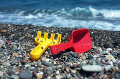 Child's rake and shovel on a beach Royalty Free Stock Photography