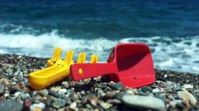 Child's rake and shovel on a beach Royalty Free Stock Image
