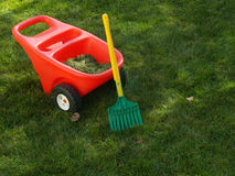 Child's rake and wheelbarrow Royalty Free Stock Photography